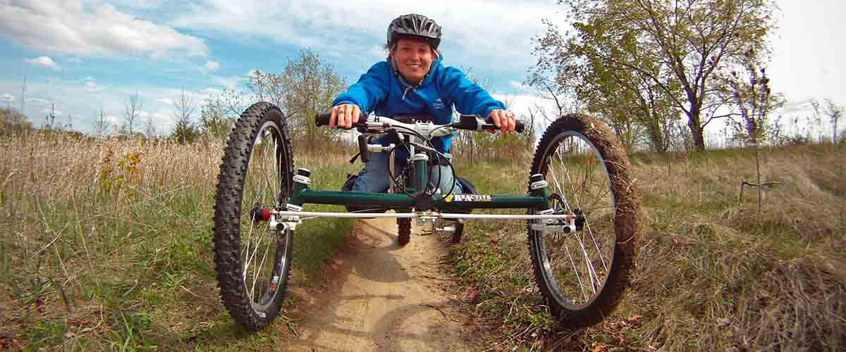 Woman riding an adapted mountain bike