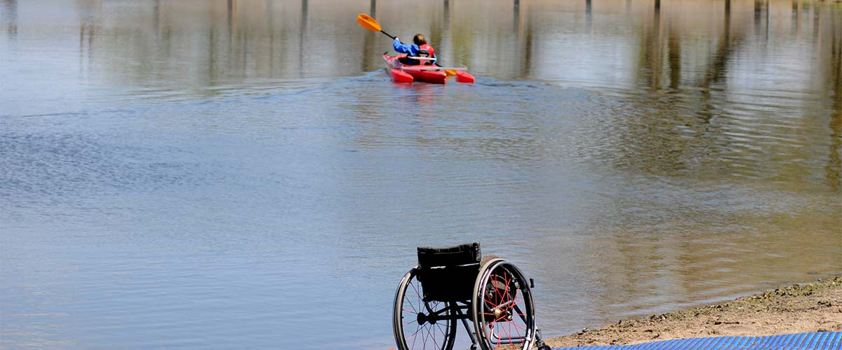 kayaker using adapted equipment