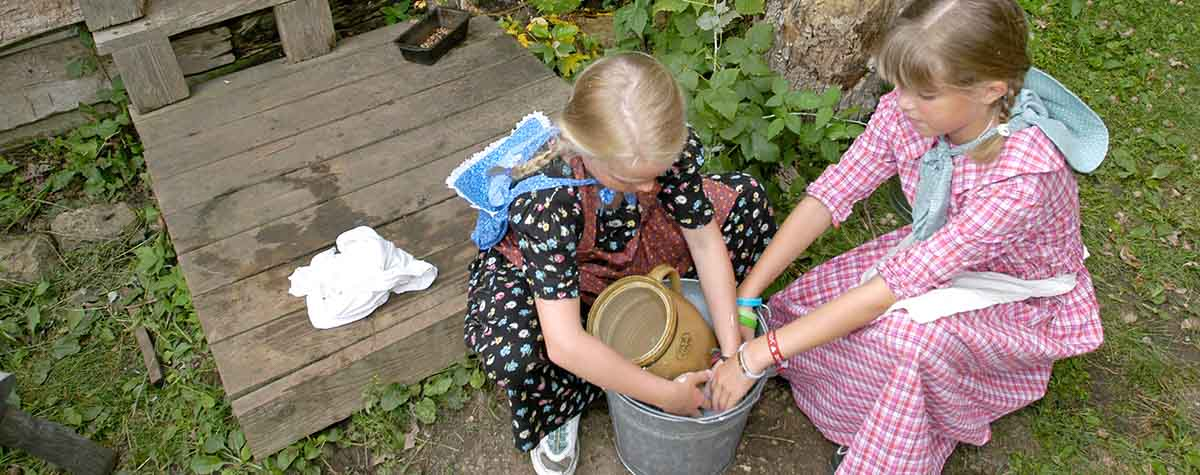Two girls in period costumes