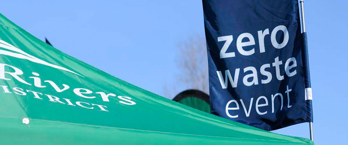 a large flag with the words 'zero waste event'