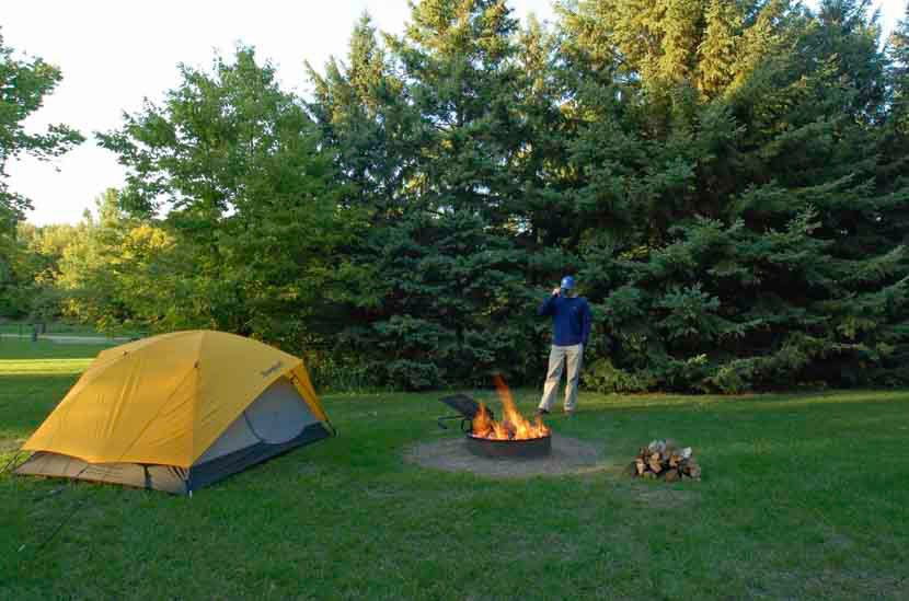 Camp fire and tent