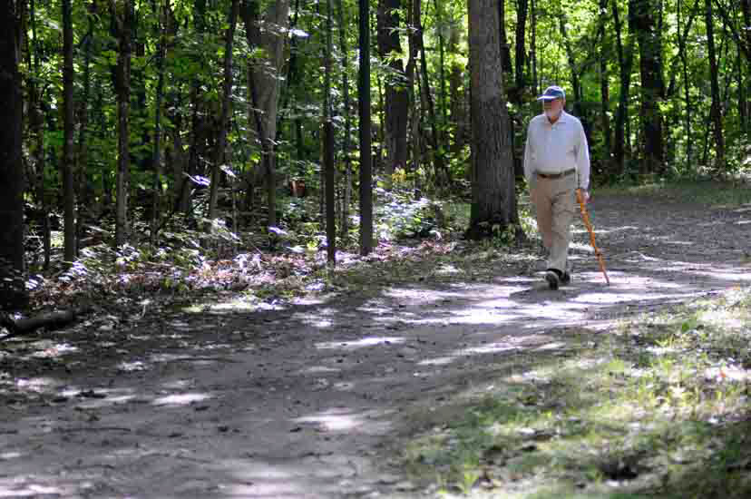 Man walking on wooded trail