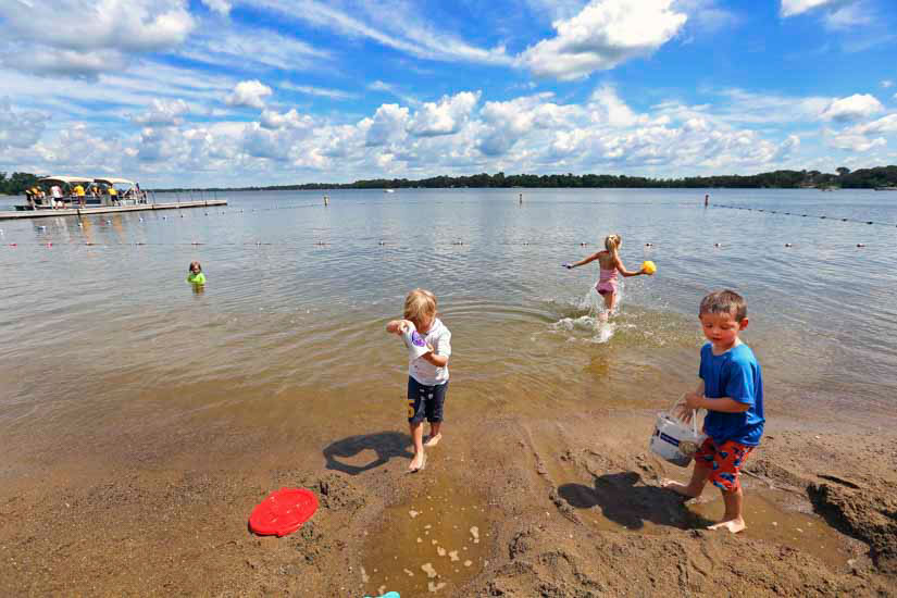 Children playing in lake