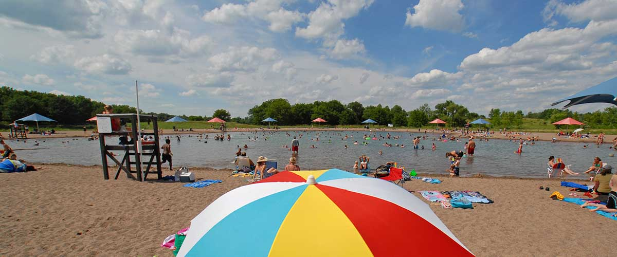 Swim pond with multi color sun umbrella