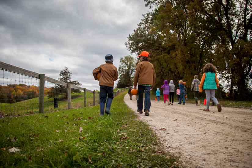 Children hiking farm trail