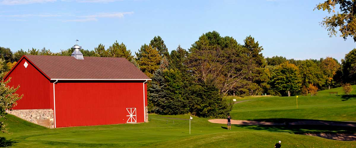 Golf course and red barn