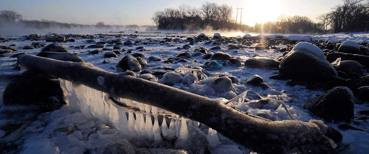 Frozen and steaming river