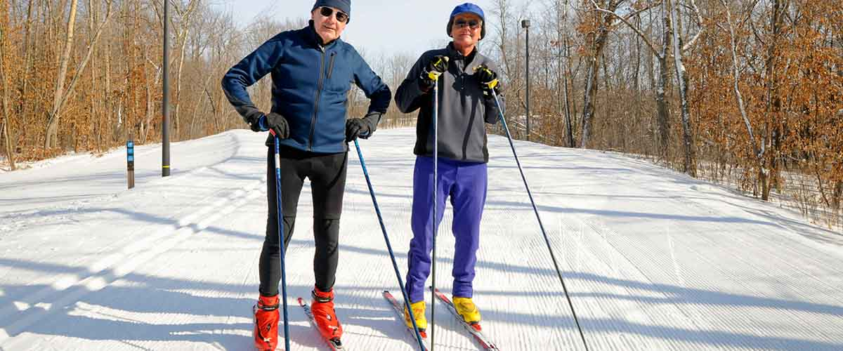 Cross-country skiers on groomed trail