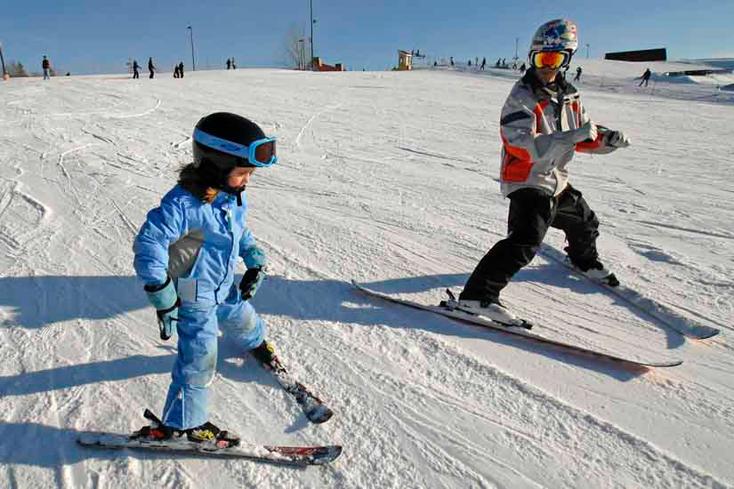 Child and instructor on ski hill