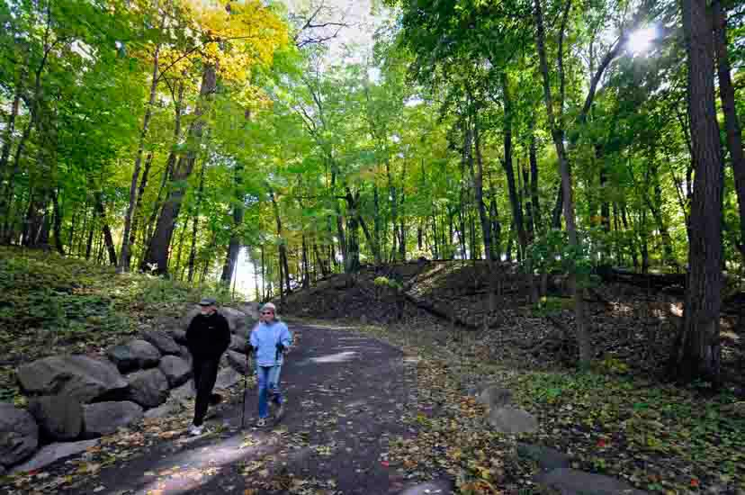 Couple hiking wooded trail