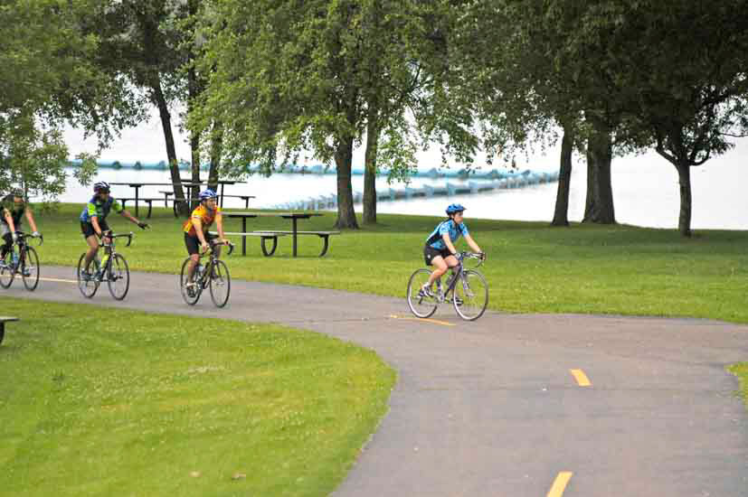 Group biking on paved trail