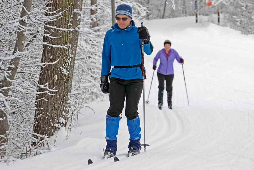 Skiers on a groomed trail