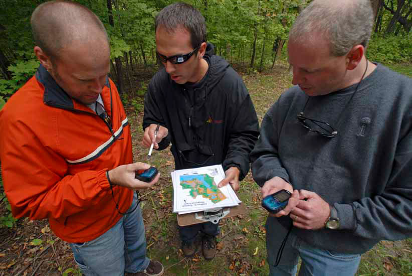 Group looking at GPS units
