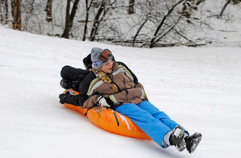 Kids sledding on hill
