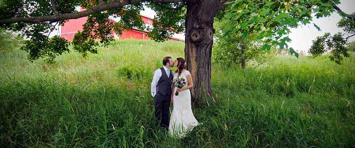 Bride and groom under oak tree