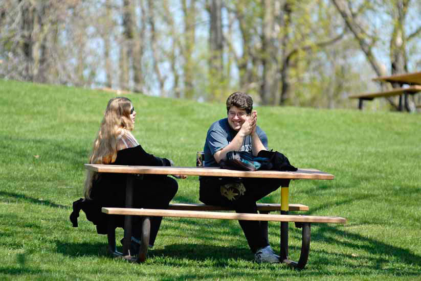 Couple enjoying picnic on a hillside
