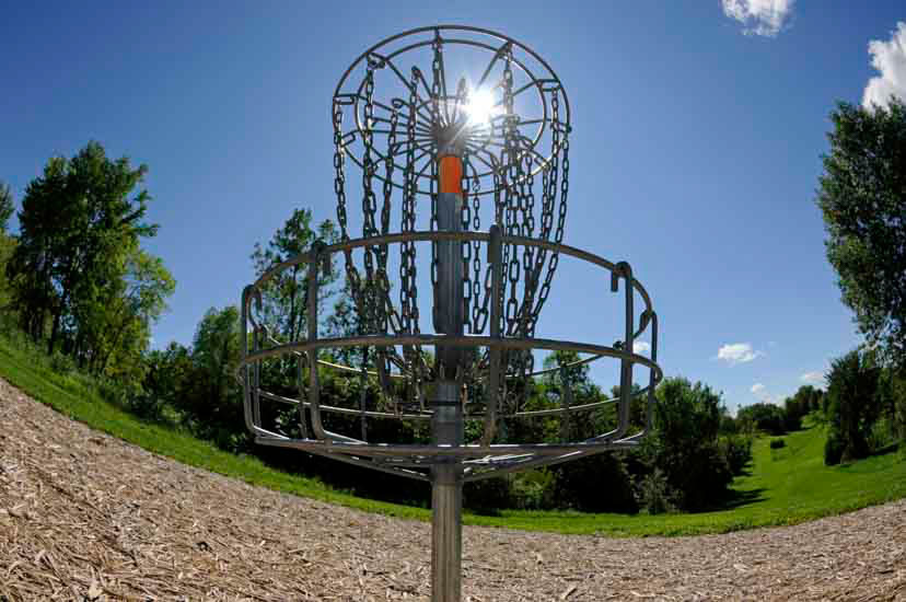 Disc golf basket and hillside