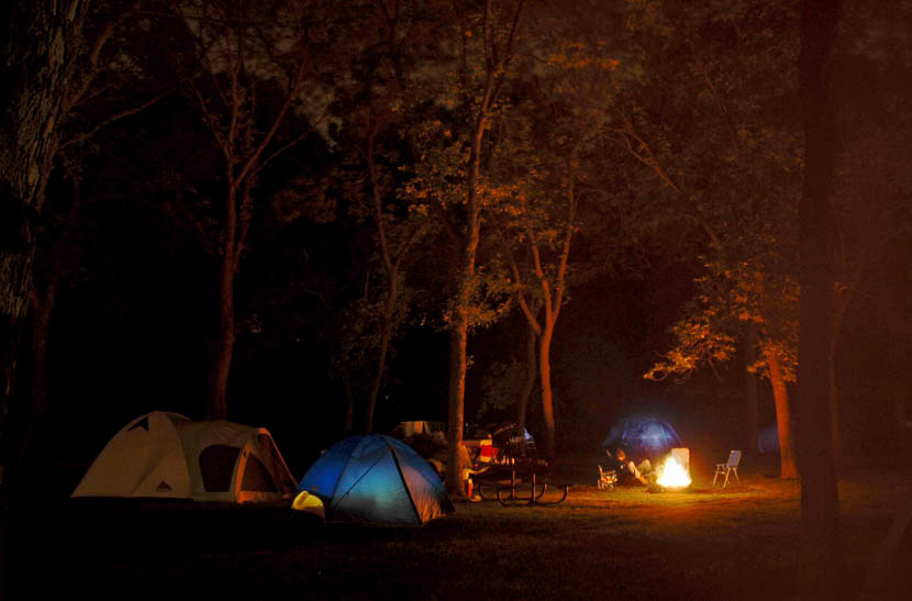 Campfire and tents at night