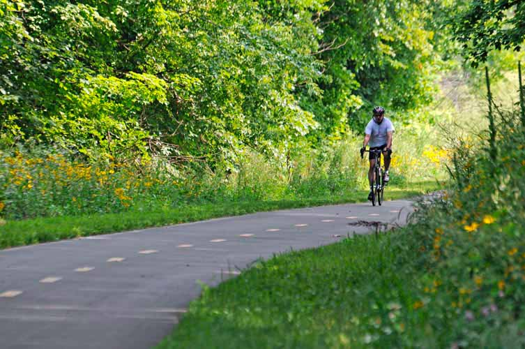 Biker on a paved trail