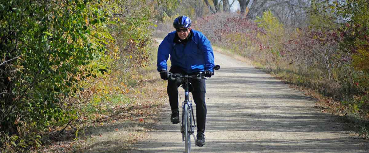 Man biking on gravel trail