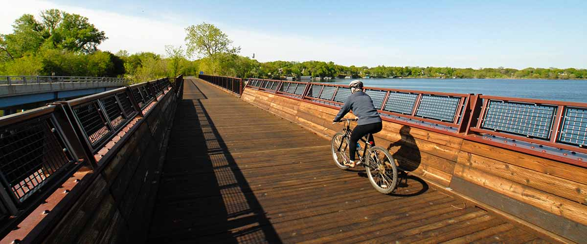 Biker on bridge along Dakota Rail Regional Trail