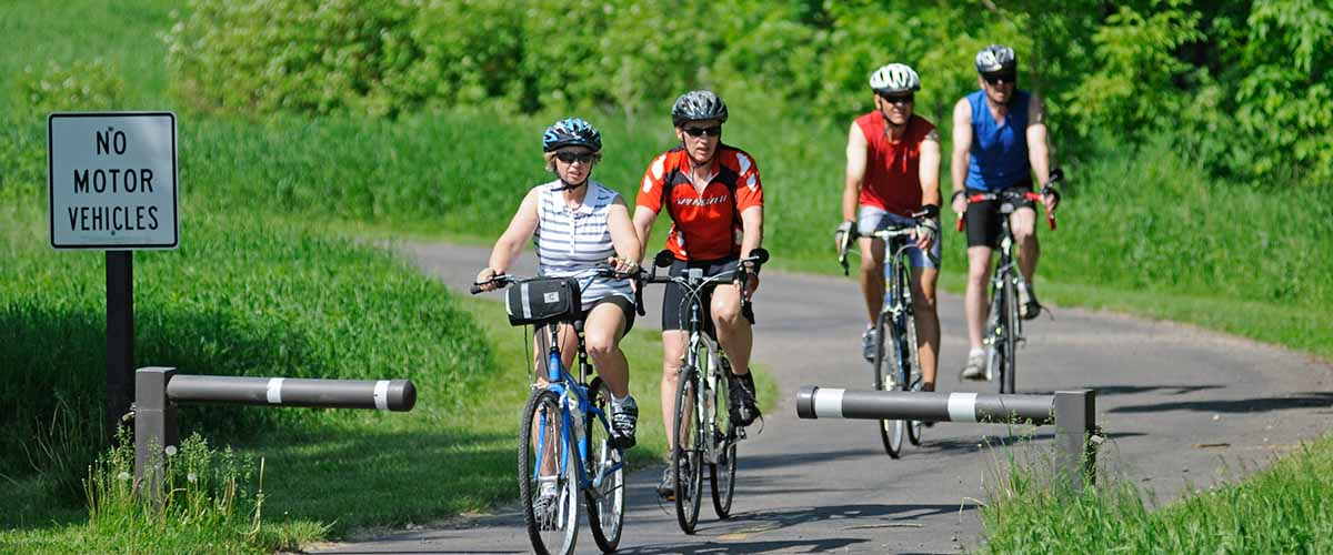 Group of bikers on paved trail