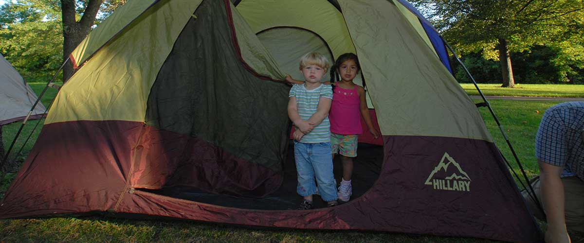 Children in door of tent