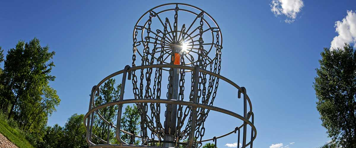 Disc golf basket and blue sky