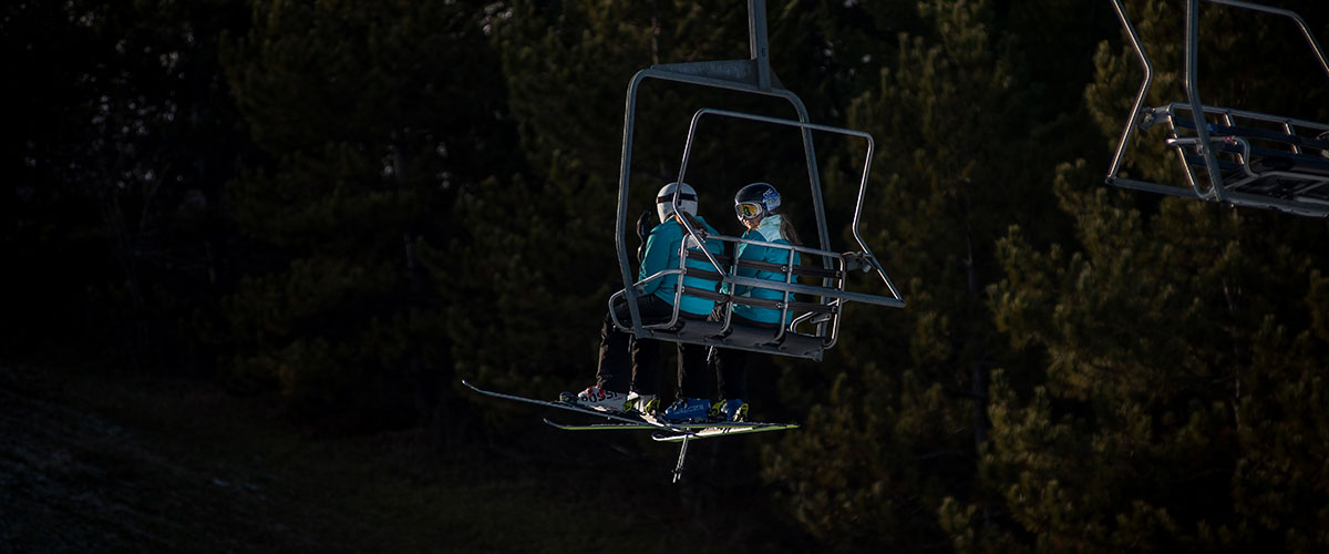 Skiers on chair lift