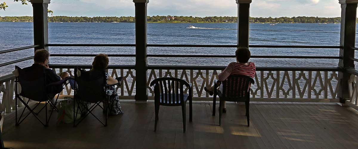 Garden visitors in the gazebo viewing Lake Minnetonka