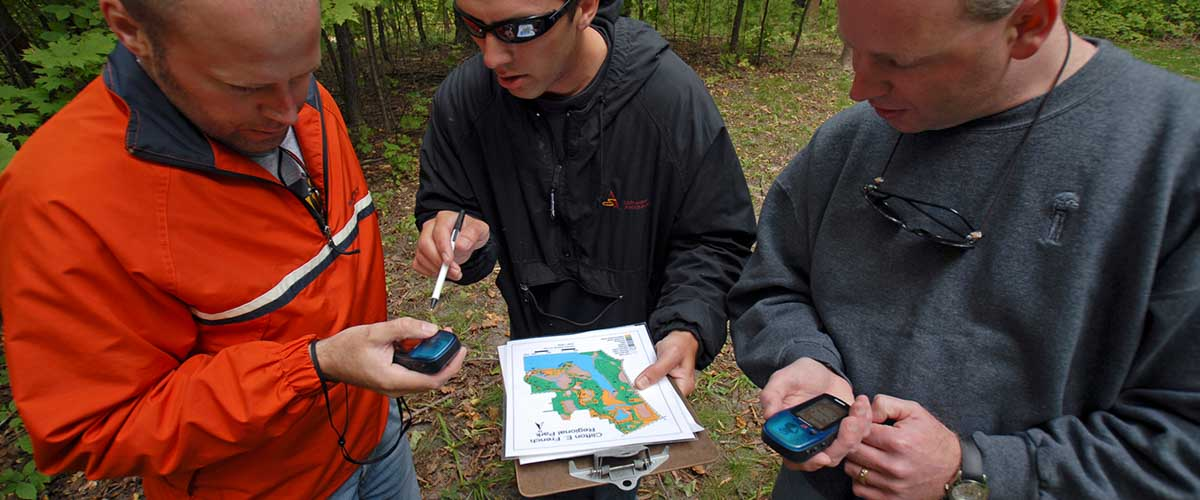 Group review a map and GPS units