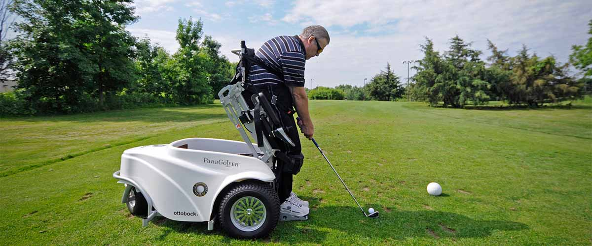 Golfer preparing to drive ball from accessible cart