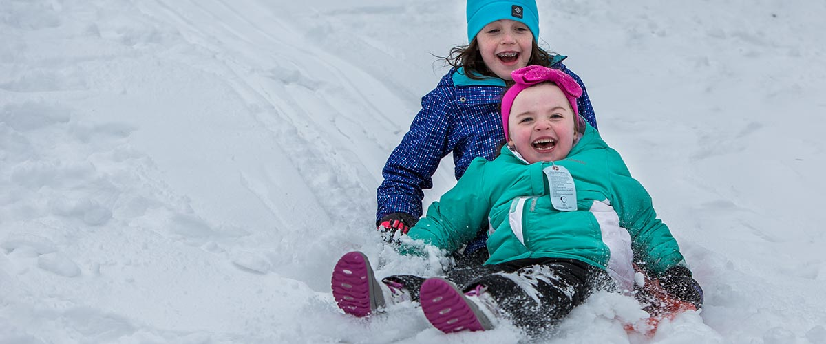 Two young children on sled