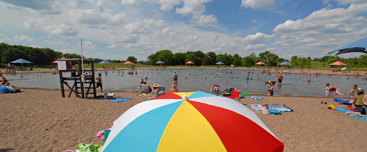 View of swim pond with beach umbrella