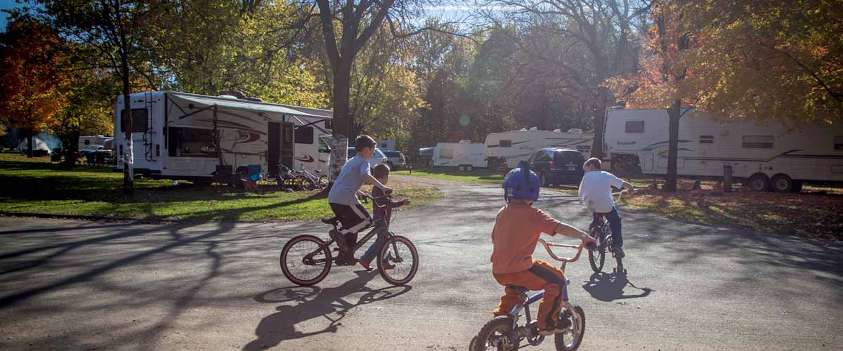 children riding bicycles in campground