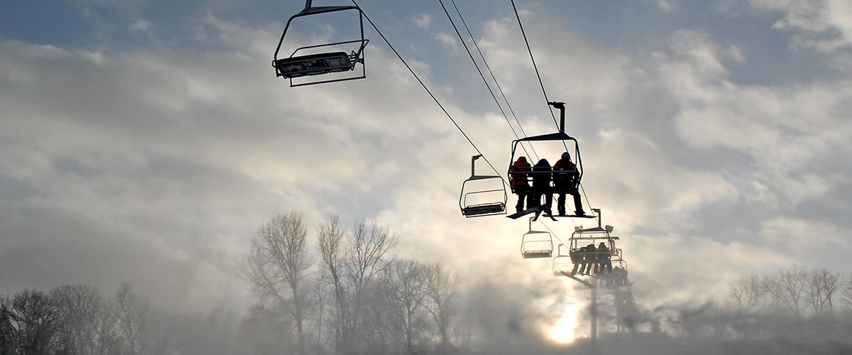 the silhouette of a chairlift