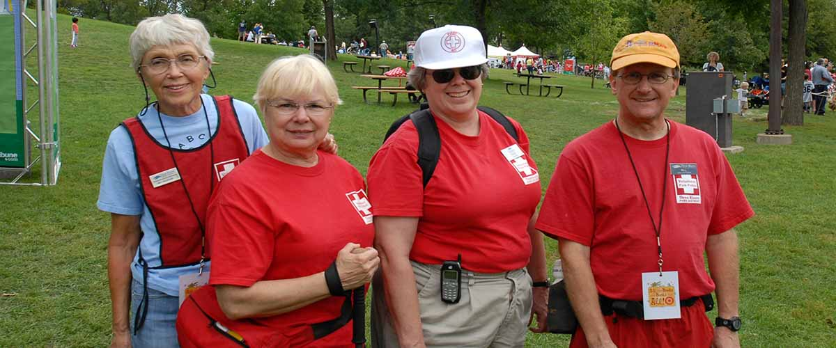 four women in volunteer shirts