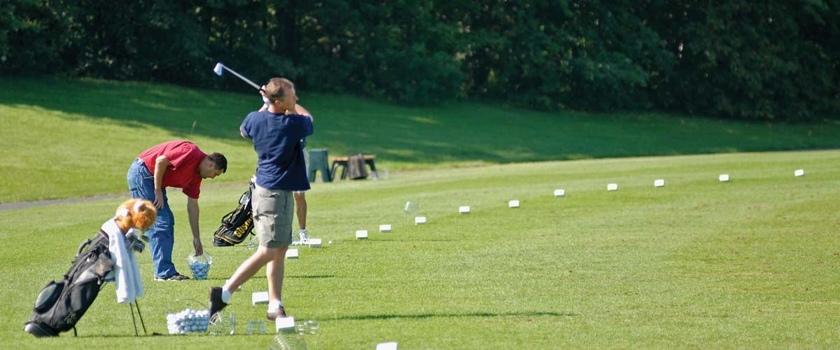 Golfer at driving range