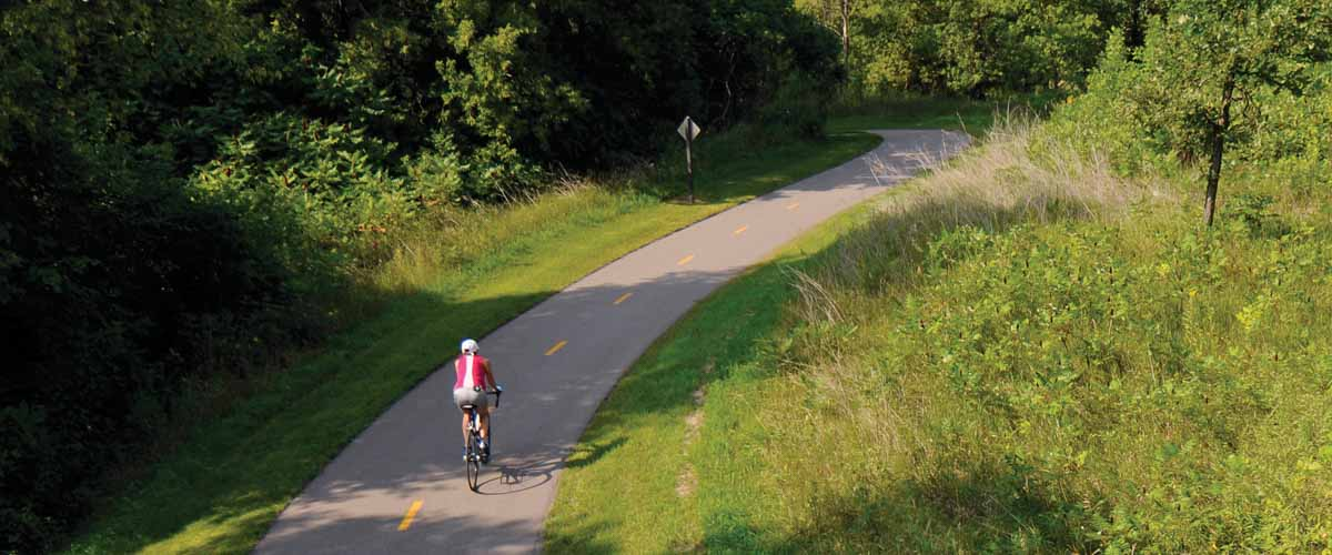 bicycle rider on a paved trail