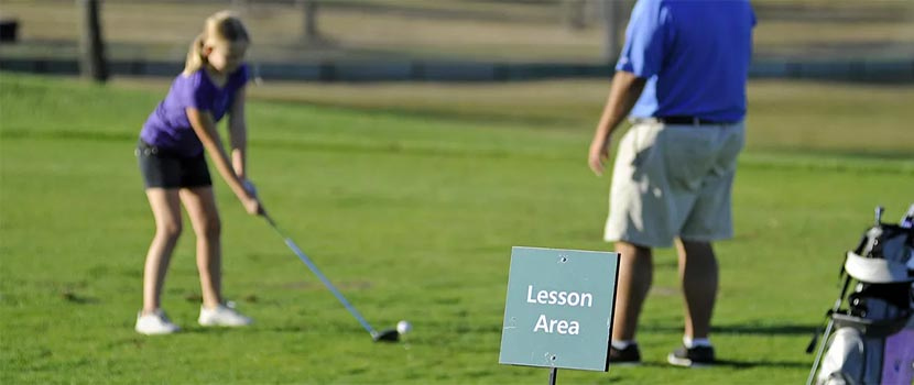 Young golfer in lesson