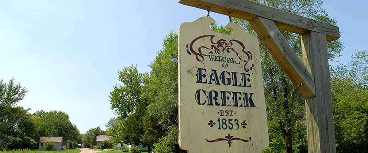 "An old-fashioned sign with ""eagle creek"" written on it"