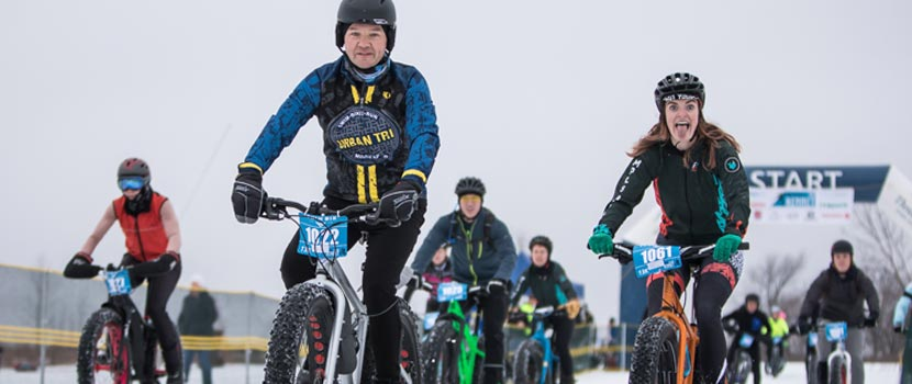 People riding fat bikes in snow