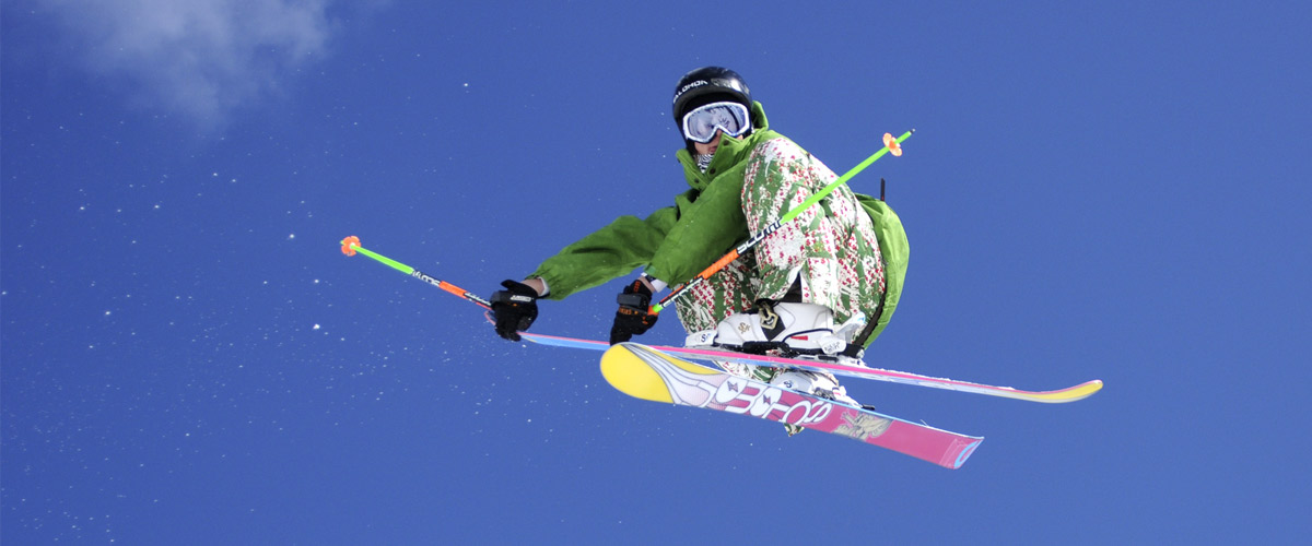 skiier in a jump. view from underneath.