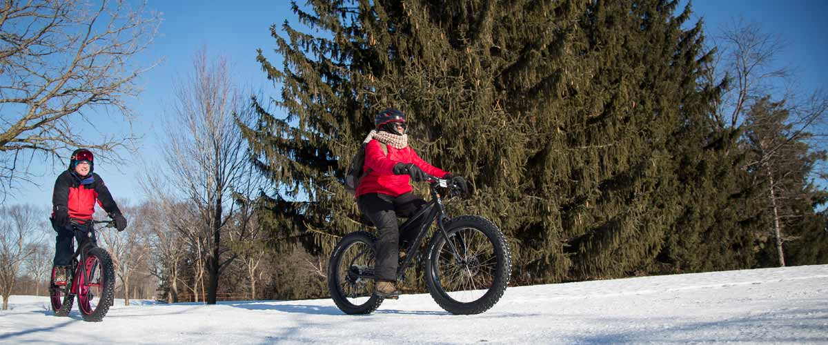two people riding fat bikes in the winter