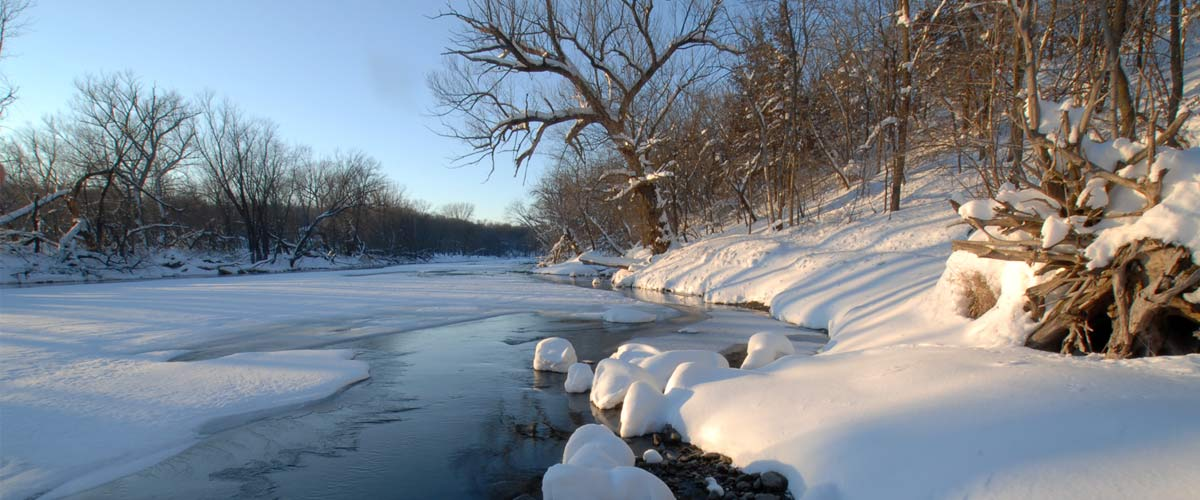 river in the winter with snowy banks