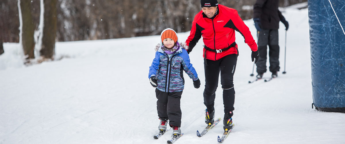 Dad and daughter cross-country skiing