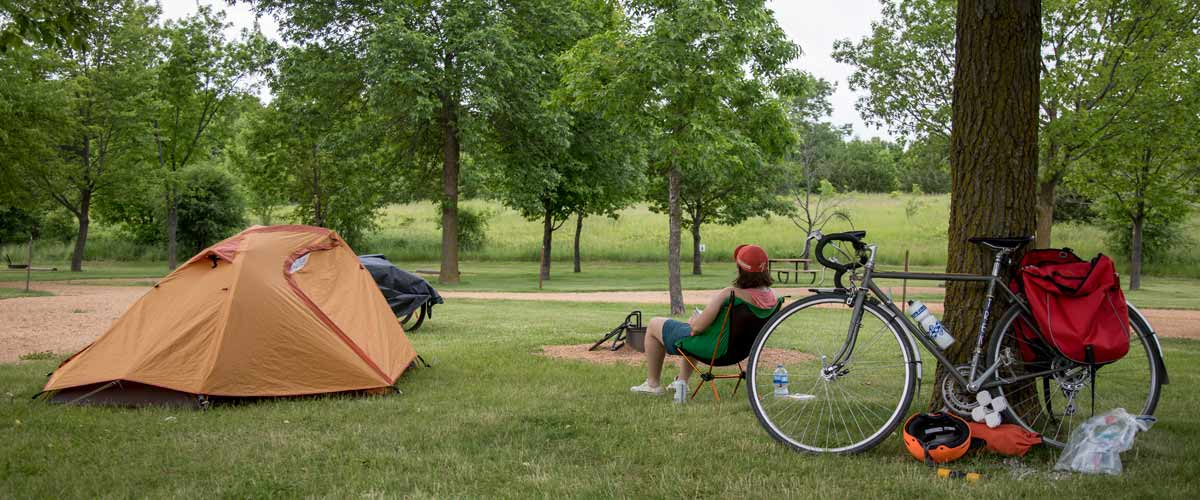 a campsite with a tent and a bike.