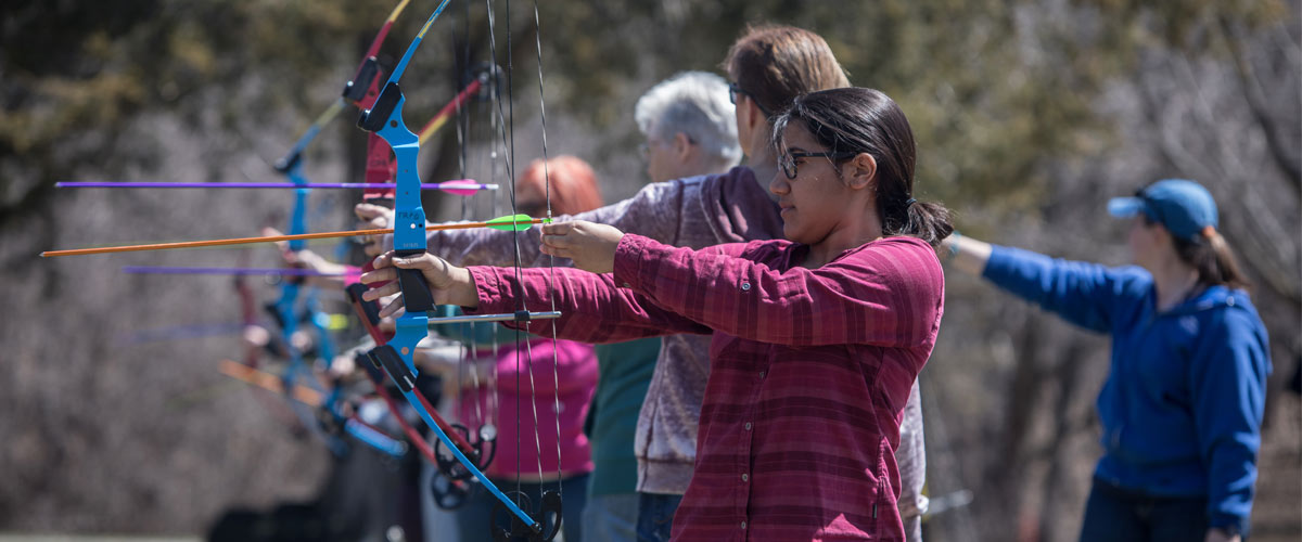 women aiming arrows