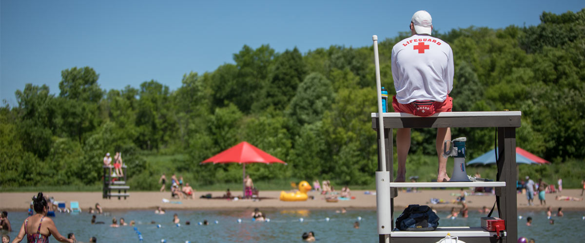 A lifeguard watching over a swim pond