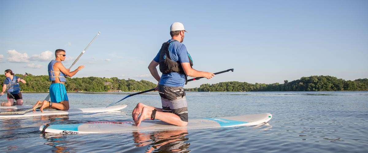 to men on stand up paddleboards